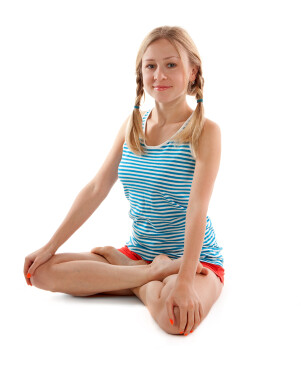 Girl with pigtails doing yoga